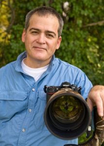 Image of Brian J Zwit with camera and big glass
